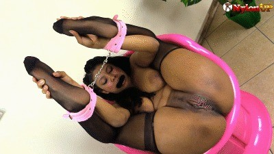 Beautiful Black Girl All Tied Up Shows Her Soles In Black Stockings And Pees On The Floor